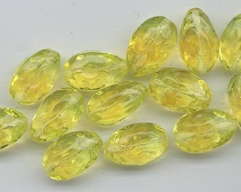 Ten lovely vintage Czech pressed glass beads - jonquil with subtle topaz clouds - 15 x 9