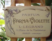 vintage,parma violette parfum,French advertising image,sealed onto wood with string hanger