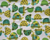 Turtles.  fabric by the yard.  Baby boys.  Cut by the 1/2 yard (18 inches, 45.72 cm).  Gray, blue, yellow, green.