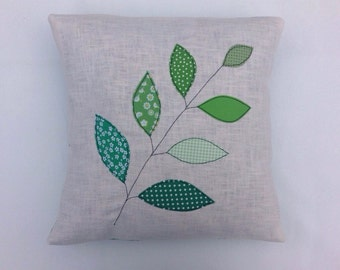 """Cushion cover, emerald green leaves on a branch, free motion applique, linen, cotton, 16"""" / 40cm."""