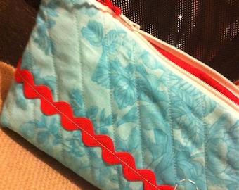 Aqua zipper bag with cheery red trims