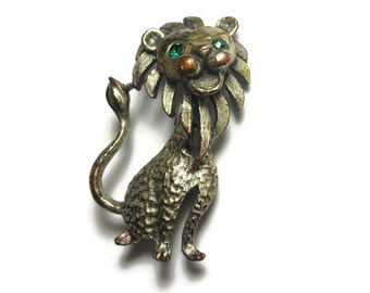 1940s Lion brooch, Leo the lion with green rhinestone eyes cheeks turned ruddy from age, silver rubbing to reveal copper patina, zodiac