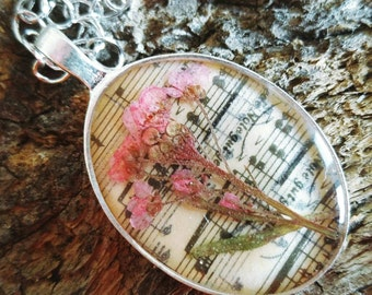 Pink allyisium resin jewelry pressed flower necklace. pressed botanical Pendant on vintage sheet music