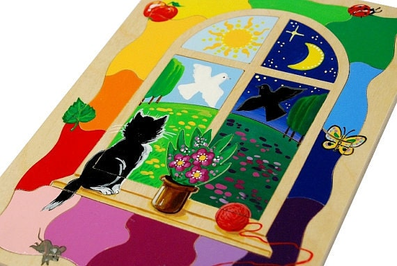Developing wooden puzzle with a cat in the window ( puzzle for children age 3- 4 )