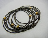 Piano Wire Bracelet Slate with silver and gold beads