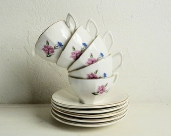 Vintage Set of 5, CARNATION CUP and SAUCERS, Cream White with Pink and Blue Floral Pattern. Stamped Digoin Sarreguemines, Made in France.