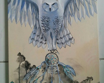 Owl flying with dream catcher bird over abstract background dark bushes