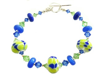 Lime and vibrant cobalt blue lampwork bracelet  with genuine blue and peridot Swarovski crystals, Sterling Silver heart clasp