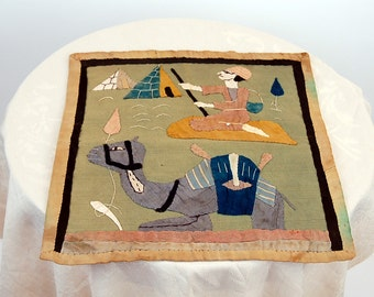 Antique Egyptian revival appliqued wall hanging with camel and pyramids 1920s art deco