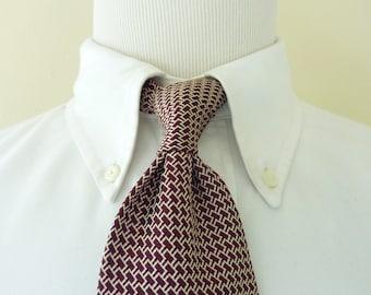 Vintage POLO by Ralph Lauren 100% Silk Cream & Red Interlocking Key Pattern Trad / Ivy League Neck Tie.  Made by Hand in USA.