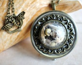 Nautical music box locket, round locket with music box inside, in bronze with tiny sea life treasures encased in glass