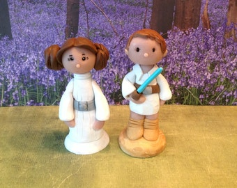 polymer clay cake topper,Luke and Princess Leia, inspired by Star Wars.