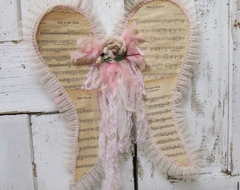 Music sheet angel wings antique wire form wall hanging shabby romantic chic adorned in pink and muted colors home decor anita spero design