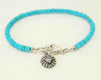 AA+ Sleeping Beauty Turquoise Bracelet with Cubic Zirconia Sterling Silver Flower Charm