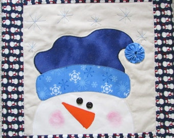 Snowman wallhanging ,table topper ,door hanging machine appliqued and quilted