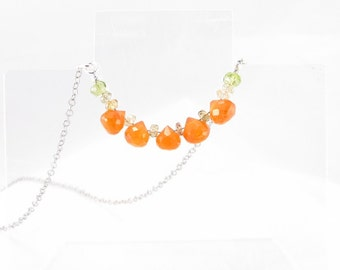 Necklace, carnelian briolettes with tourmaline and peridot rondelles