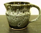 Pitcher in Black and White Glaze...