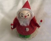 Cute vintage rolly Polly Christmas elf covered in glitter