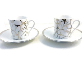 Two pairs of porcelain coffee cups of Limoges with platinium