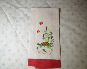Guest Towel or Hand Towel with Turtles and Butterflies Near a Stream