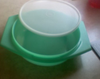 """Tupperware, bowl & lid, vintage green, with lid, bowl is abt. 8-1/2 x 2-3/4"""", overall with handles abt. 11"""""""