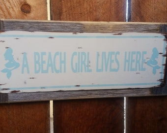 "Recycled wood framed ""Beach Girl Lives Here"" street sign"