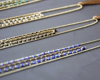 Saltire the charming double fine chain row beaded feather gilded brass