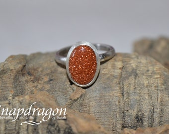 Sterling silver bezel set Goldstone cabochon ring UK Size M Us size 6.5