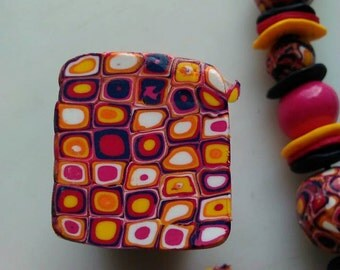 Handmade Polymer clay extruded cane, Warm pinks and navy. Unbaked Fimo