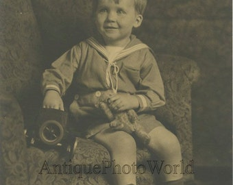 Cute smiling boy with toy car and teddy bear antique photo