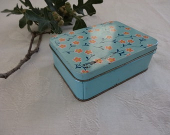 Vintage blue tin box with orange flowers and Bluebird notepaper.