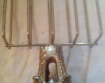 Antique brass gold krmulu napkin or letter holder