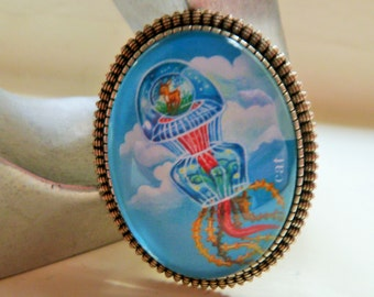 "Glass Cabochon Brooch ""Jellyfish in the sky"", silver color frame."