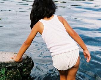 Young girl taking a bath at Sumatra, Indonesia