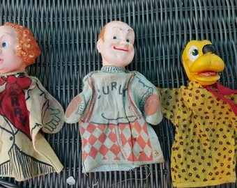 Three vintage 1950's hand puppets.