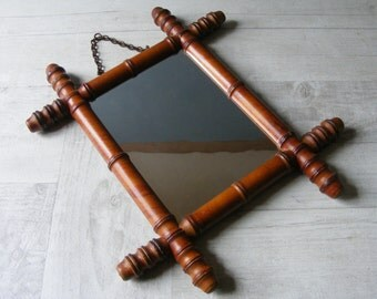 French Antique  Wooden Faux Bamboo Mirror,with its chain and  glass mirror.