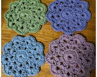 Handmade crochet coasters with matching basket holder