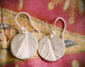 Feather disc silver earrings