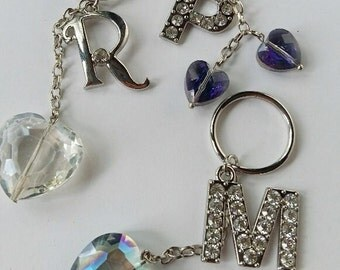 "Letters Keys Chains , Accessories Key chains , Key chains Letters""  R , P  , M,  W , C , O , U  , K , g  ""Glass Hearts Key chains"