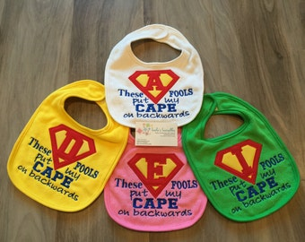 These fools put my cape on backwards, blue, cape bib, personalized baby bib, velcro bib, cute saying
