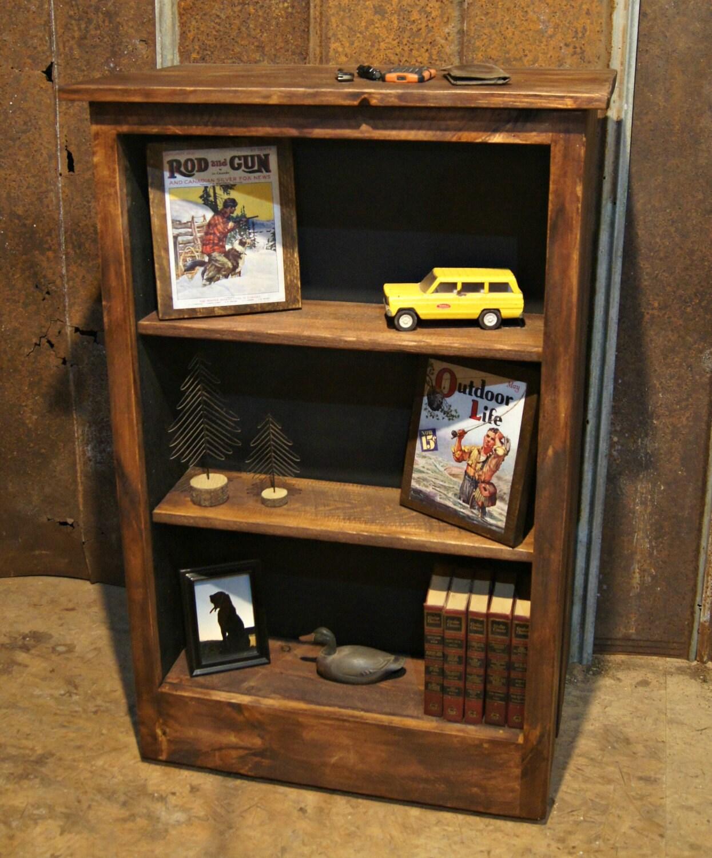 Three shelf bookcase with hidden gun storage by for Secret storage bookcase