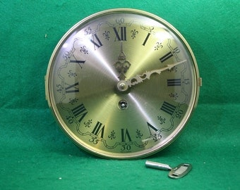 Vintage German Complete Clockworks with Doom Bezel and Key