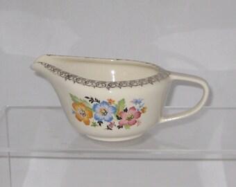 Vintage ceramic/porcelian creamer with floral and gold filigree design