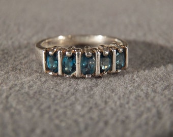 Vintage Sterling Silver Ring Dominated by a Row of Emerald Cut Blue Topaz Stones, Size 8  **RL