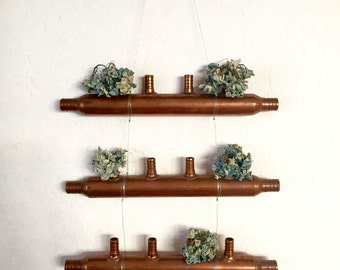 Hanging copper pipe sculpture