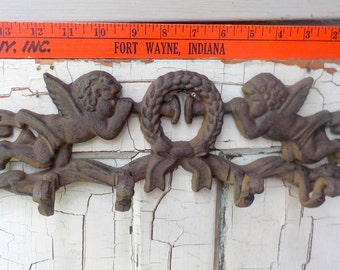 Vintage Cast Iron 4 hook hanger with cherubs angels and wreath.  Useful Decor