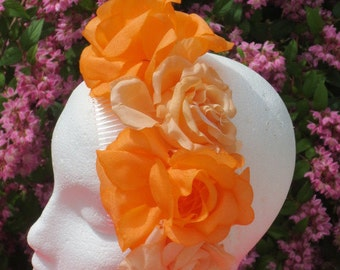 Orange silk flower on comb .
