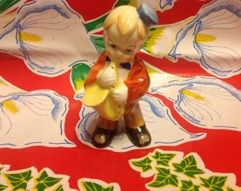 Vintage hand painted saxophone playing boy figurine-Japan