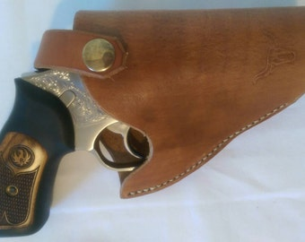 Small leather holster, right handed, hand stitched cow hide, trigger guard, buckskin color, long horn stamp, fits 2-3 inch barrels