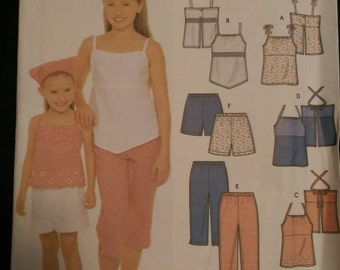 Simplicity 5178. Size HH 3,4,5,6. Child's and girls' tops, pants or shorts and scarf. Easy-to-sew. Uncut and factory folded.